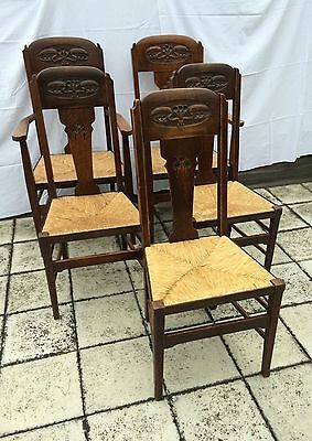 Quintessentially Arts and Crafts: 5 rush-seated, stained oak dining chairs