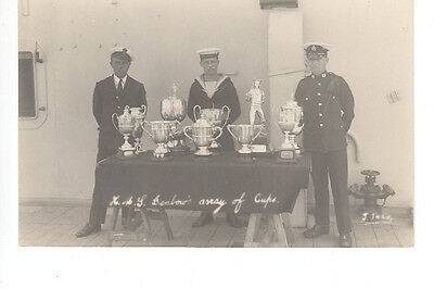 RPPC showing Cups & Awards on HMS Benbow with sailors and Royal Marine?