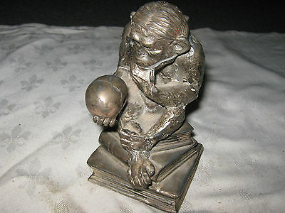 An Antique Britannia Metal Shakespearean styled Monkey Holding Skull Inkwell
