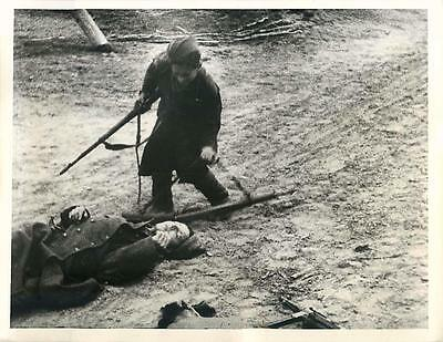 WWII Russian Guerrilla Soldier Takes Rifle of Fallen Enemy Soldier Press Photo