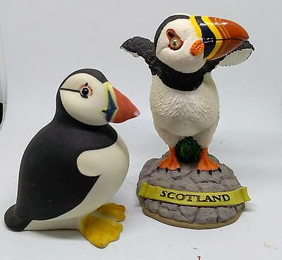 Two puffin figures