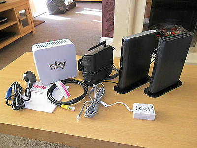 assorted modems and a sky hub