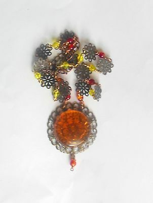 Orange vintage style necklace with glass beads and resin pendant.