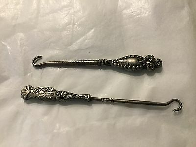 Two small antique sterling handle glove button  hooks H & H