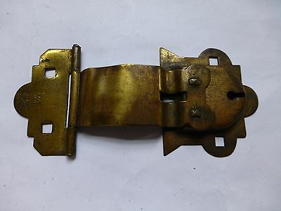 An antique TW&Co buckle lock in brass - architectural salvage