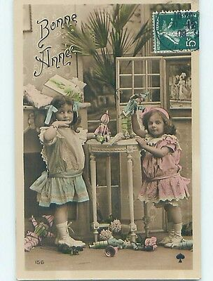 1908 rppc CUTE GIRLS PLAYING WITH ANTIQUE DOLLS HM1273