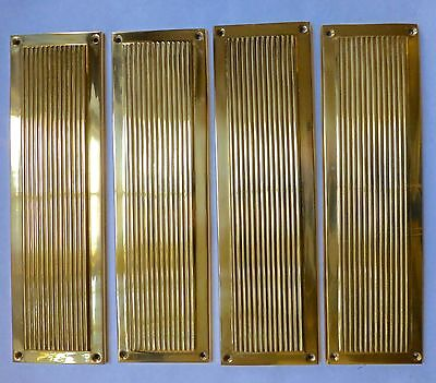 Four vintage reeded finger plates in brass - salvage
