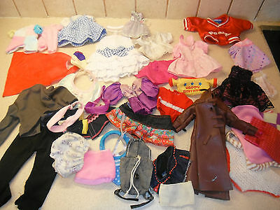 bundle of assorted dolls clothing A