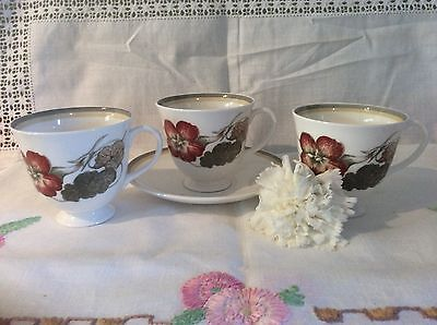 """Susie Cooper """"Nasturtium"""" Pattern 3 Tea Cups and One Saucer Good For Spares"""