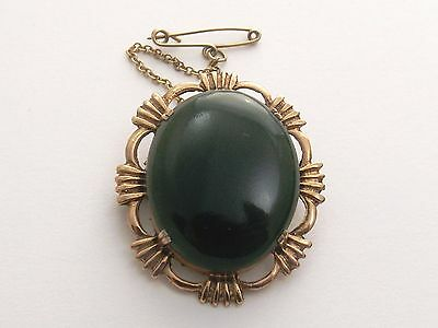 GOLD OVAL BROOCH WITH VERY DARK GREEN STONE  Agate or Jade  9ct