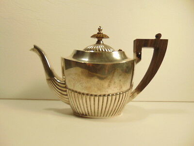 Older sterling silver small 7/8th pint tea pot: on bottom - George H. Ford Co.