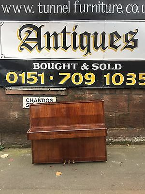 overstrung upright piano
