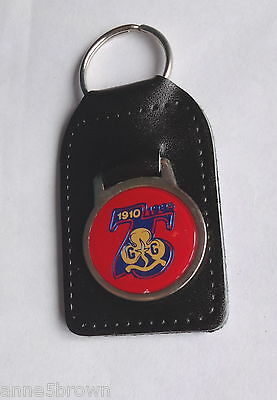 UK GIRL GUIDES: 1985 - 75th ANNIVERSARY OF GIRLGUIDING KEY RING & LEATHER FOB