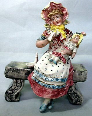 Antique Majolica Figurine Girl seated on Bench marked on base
