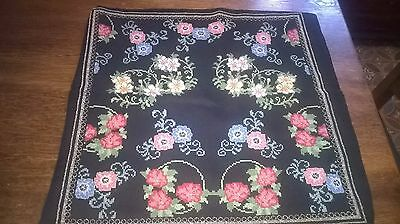completed cross stitch    lovely floral design, made into a cushion cover