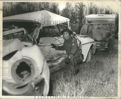 1968 Press Photo Accidents- State Police Sgt., Abner C. Touns looks over car.