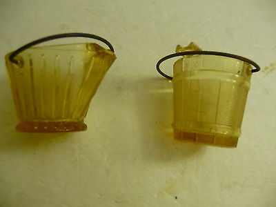 Depression Glass   Small pitcher and small barrel  ( Yellow/Amber ).
