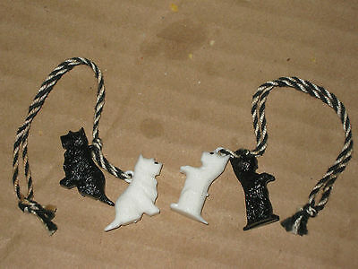 A Vintage Pair of Black & White Scotch Whisky Advertising Miniature Collar Dogs