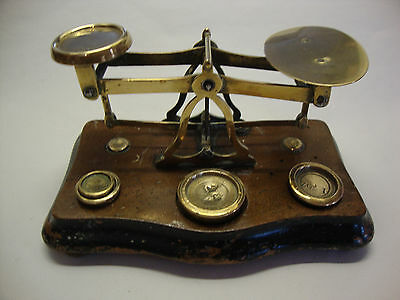 Antique set of brass postal scales on wooden base with weights