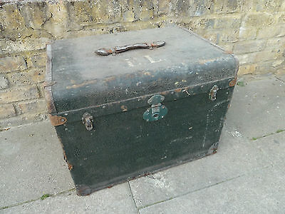 Antique black steamer luggage or cabin trunk