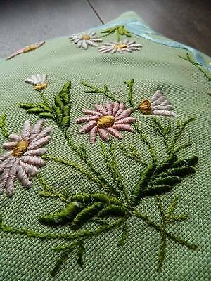 Vintage hand embroidered cushion cover - design of pink daisies on green.