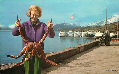 1950s Woman holding King Crab by waterfront ALASKA Teich postcard 12633