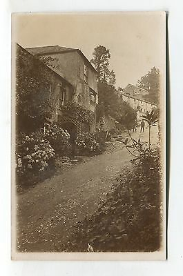 Unknown village - houses on hillside, boys on path - old real photo postcard
