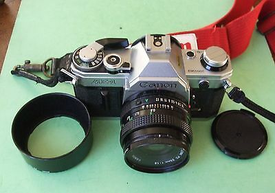 Canon AE-1 35mm SLR Film Camera with 50mm f/1.8 Lens + Access.
