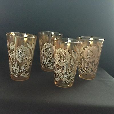 """4 COSMOS pattern GLASSES by JEANNETTE in NICE CONDITION iridescent  Amber 4 3/4"""""""