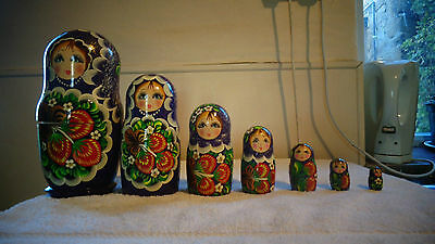 7 matryoshka dolls , also known as Russian nesting/nested dolls, beautiful paint