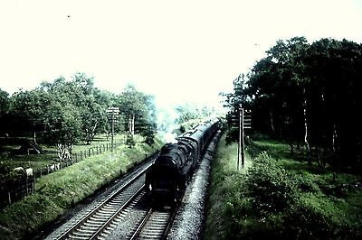 Original Colour slide Stnd 5 4-6-0 73154 (65B) at ?..Sold with copyright