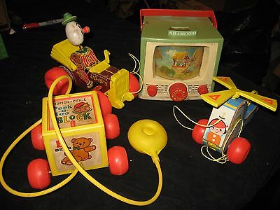 Lot of 4 vintage fisher price toys.  Copter, Jalopy, Peek a boo box & screen
