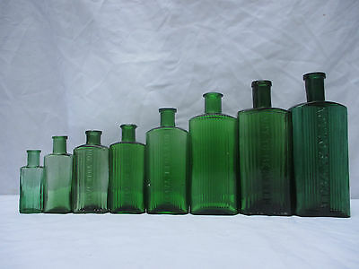 Superb Set Of 8 Vintage Green Oblong Ribbed Poison Bottles Apothecary Cure