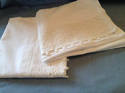 "Matching pair of white cotton pillowcases with a 3.5"" deep heavy lace edge"