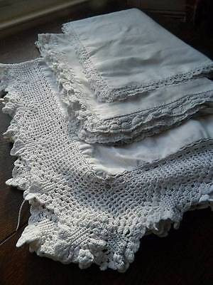 Three antique white cotton Oxford pillowcases with hand crochet lace borders