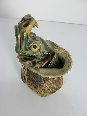 Clay/Ceramic Mythical Dragon in a Sack Figurine