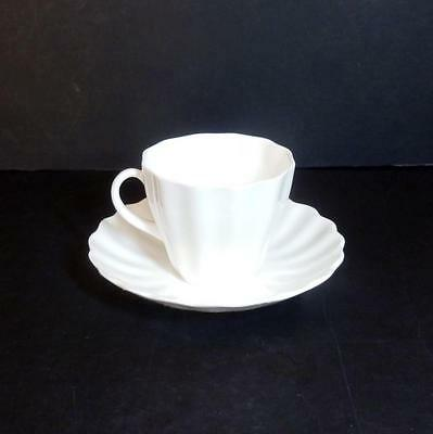 Royal Doulton vintage demi-tasse. coffee cup and saucer -  Pure white, fluted.