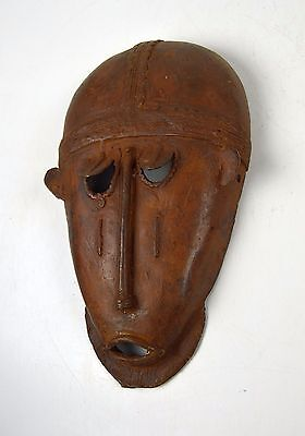 A Fine Senufo Bronze mask with Archaic face, African Tribal Art