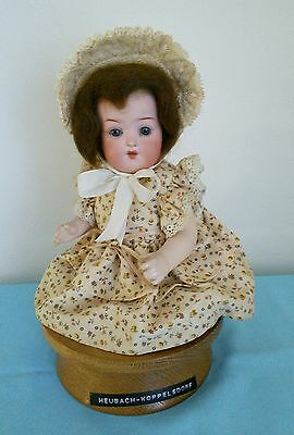 Small Antique Bisque Head Heubach Koppelsdorf Doll. Sat On Musical Stand