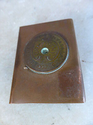 Antique copper matchbox holder one penny from Rhodesia and Nyasaland dated 1957