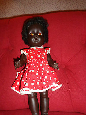 """vintage black vinyl baby doll approx 14"""" good condition Including Dress"""