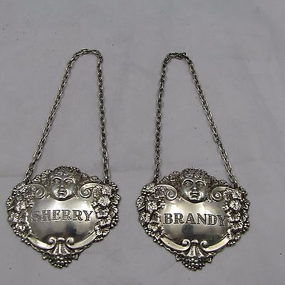 Pair Of Silver Decanter Lables Sherry Brandy Cherub Decoration  Mappin Webb 1967