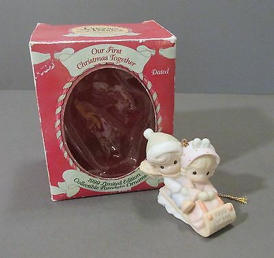 """Precious Moments 1999 """"Our First Christmas Together"""" Couple on Sled Ornament"""