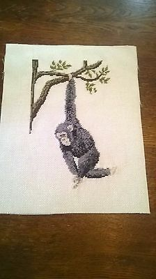 Completed Cross Stitch Of A Wild Monkey Swinging On Atree