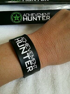 2  Achievement Hunters exclusive wrist Band  Rooster Teeth