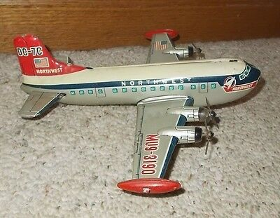 "9 3/4"" Long Japan Tin Airplane DC 7C Friction Northwest Airlines"
