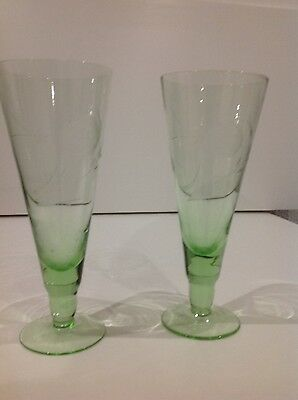 2 tall green patterned vintage glasses