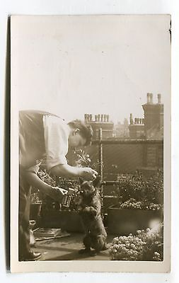 Unknown city - man & dog on rooftop garden - old real photo postcard