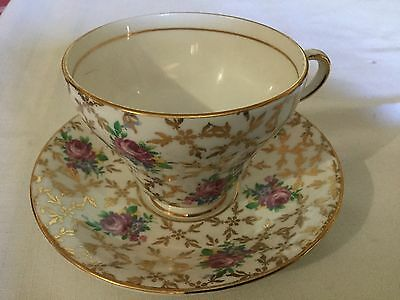 Clare Bone China Cup And Saucer England    White/gold Chintz/roses