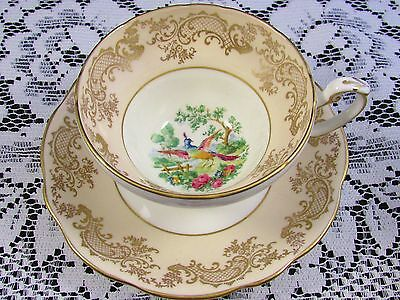 Foley Creamy Beige Intricate Gold Designs Bird Scenic Tea Cup And Saucer
